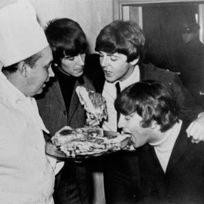 The Beatles eating pizza