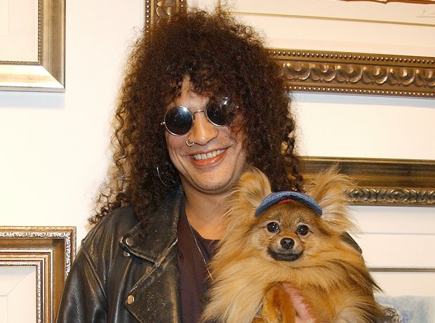 Slash with his dog Foxy Brown