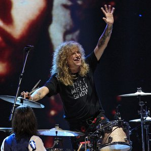 Steven Adler performing with Axl Rose and Duff McK
