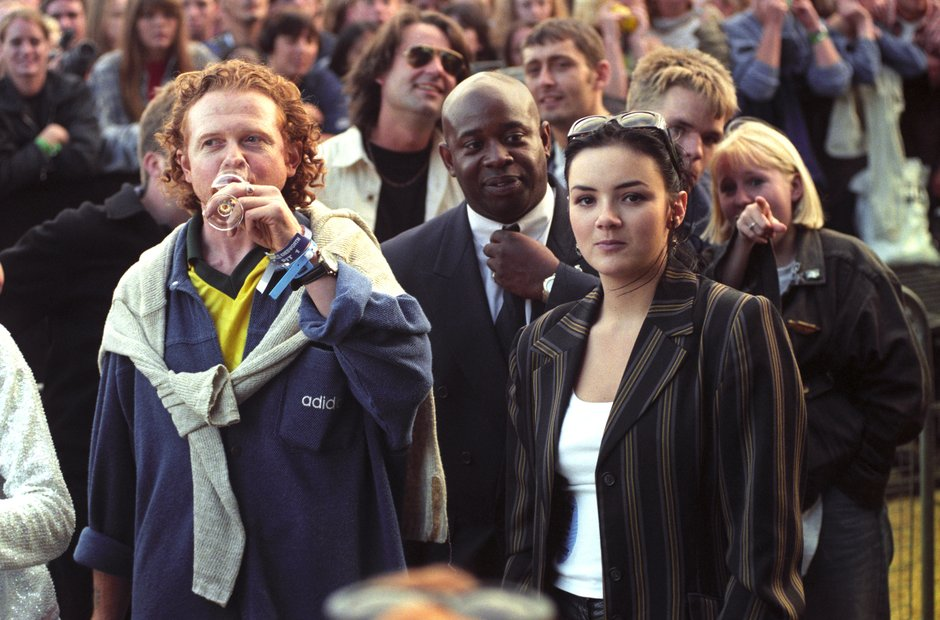Mick Hucknall and Martine McCutcheon watching Oasis at Knebworth