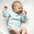 Crying newborn baby stock image