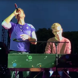 Coldplay's Chris Martin performs with fan